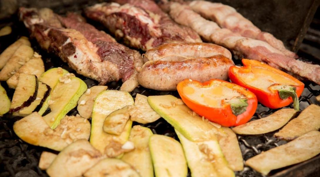 Meat and veggies roasting at an asado in Argentina.